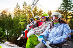 Four snowboarders sitting in elevator Stock Photos