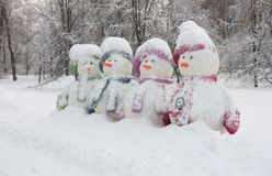 Four snowmen. Covered with snow Stock Photography