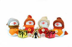 Four snowmen with gifts Royalty Free Stock Image