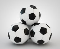 Four soccer balls faced pyramid on white. 3d render of four soccer balls faced pyramid on white background Stock Images
