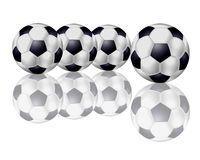 Four Soccer Balls in a Row Royalty Free Stock Image
