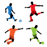 Four soccer players silhouettes Stock Image