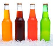 Four Soda Bottles in Ice Stock Photo