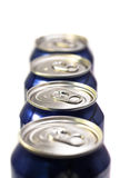 Four soda cans. Four cans of sosa in a row with the focus on the lid of the second one Stock Photography