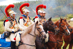Four soldiers riding horses. Royalty Free Stock Photography
