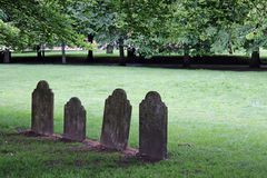 Four Solitary Gravestones. In church yard Royalty Free Stock Images
