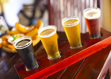 Four sorts of beer. Ale, porter, lager, pilsner Stock Photos