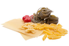 Four sorts of pasta and tomatoes Royalty Free Stock Photo