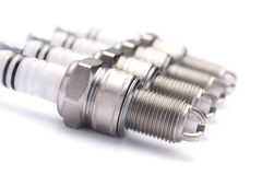 Four spark plugs for car's engine Royalty Free Stock Photos