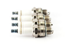 Four spark plugs Stock Photography