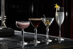 Four special cocktails on a bar desk. black background royalty free stock photo