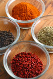 Four spices (vertical) Royalty Free Stock Photos