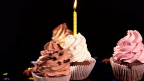 Four spinning decorative iced cupcakes stock video footage