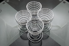 Four spiral egg cups Royalty Free Stock Photos