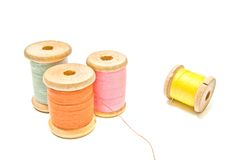 Four spools of different thread Royalty Free Stock Photo
