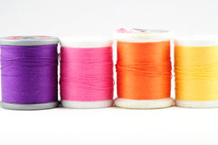 Four spools of thread on white Stock Photo