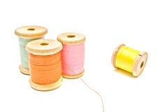 Four spools of thread Stock Photos