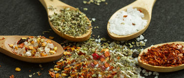 Four spoons with spices Stock Photos