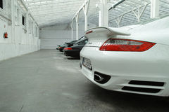 Four sports cars, white Porsche 911 Turbo Royalty Free Stock Photos