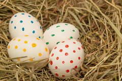 Four spotted easter eggs on hay Stock Photography