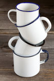 Four stacked Enamel Coffee Mug Stock Images