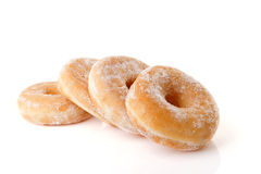 Four stacked sugared donuts over white background Royalty Free Stock Photography