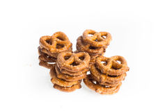 Four stacks of baked pretzels on white. Close up photography of 4 stacks of baked pretzels on white stock image