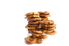 Four stacks of baked pretzels on white. Close up photography of 4 stacks of baked pretzels on white stock images