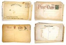 Four Stacks of Blank, Vintage Postcards. Four stacks of blank, heavily aged post cards from early 1900s.  Isolated on white Stock Photos