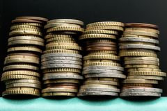Four stacks of euro coins. Money background stock photos