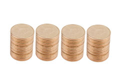Four Stacks of Gold Coins. Isolated on White Background royalty free stock photos