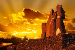 Four standing moai in golden sunset. In Easter Island stock photos