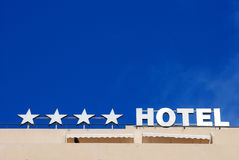 Four star hotel sign. With blue sky as background Royalty Free Stock Images