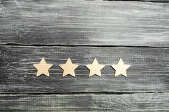 Four stars on a dark background. The concept of rating and evaluation. The rating of the hotel, restaurant, mobile application. Qu. Ality service, buyer choice stock image