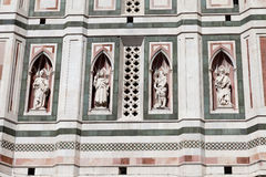 Four statues in niches on Bell Tower on Piazza del Duomo in Florence in Italy. Close up Royalty Free Stock Photos