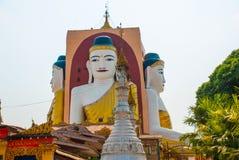 Four statues of sitting Buddhas. Pagoda Kyaikpun Buddha. Bago, Myanmar. Burma. Royalty Free Stock Photos