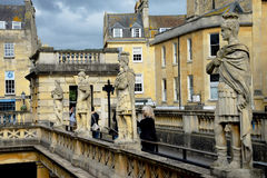 Four statues standing guard at the Roman Baths in Bath. Stock Photography