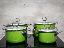 Four stewpots on induction cooker Royalty Free Stock Photography