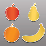 Four stickers with the image of fruit, apple, pear, banana, oran Royalty Free Stock Photography