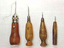 FOUR STITCHING AWLS. Four vintage stitching awls isolated on white background Royalty Free Stock Photo