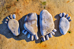 Four stone footprints Royalty Free Stock Photography