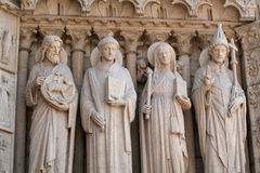 Four stone statues Stock Images