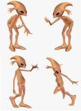 Four strange aliens posing  Stock Image