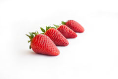 Four strawberries. One after onother stock image