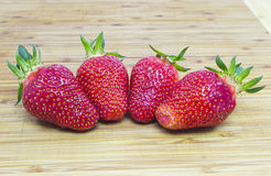 Four strawberry Stock Image