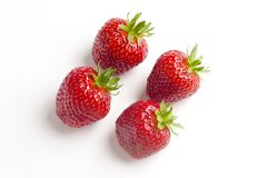 Four strawberry on white Stock Photo