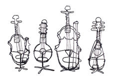 Four string instruments made of wire on a white Royalty Free Stock Image