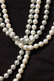 Four strings of white marine pearl stock photos