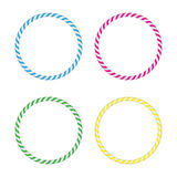 Four striped gymnastic hoops. Sports equipment. Stock Photo