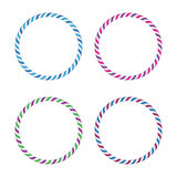 Four striped gymnastic hoops. Sports equipment. Royalty Free Stock Image
